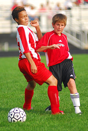 A Stanton Junior High soccer player elbows a M...